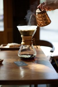 social-coffee-table-indoors-reserve-third-place-roastery-wood-chemex-hands